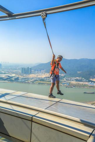 skywalk-macau-tower-china-december-happy-man-walks-outer-edge-observatory-th-floor-popular-83441479